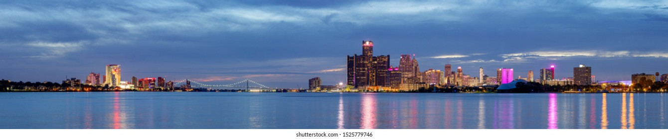 The Border Cities of Detroit, Michigan, United States of America, and Windsor, Ontario Province, Canada, connected by the Ambassador Bridge as seen from the Detroit River at Night