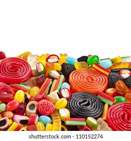 Border of colorful jelly candies on white