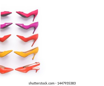 Border of different colorful high heels isolated on a white background. Fashion concept,