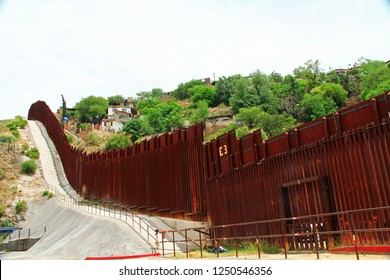 Border Fence beside a street in downtown Nogales, Arizona separating the United States from Mexico.