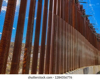 Border fence at the United States and Mexico border in Nogales, Arizona. The constantine wire was recently added to the fencing.