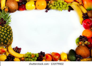 Border or frame of colorful fruits. Assortment of exotic fruits, isolated on white background.
