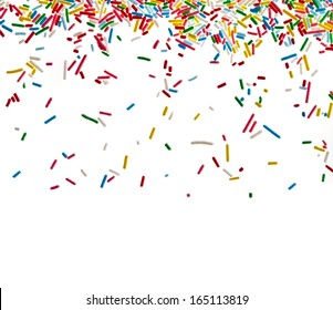 Border frame of colorful sprinkles isolated on white background card for text