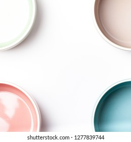 Border frames with set of empty pastel colored bowls with copy space, isolated on white background