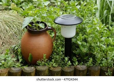 Border In Garden With Pot And Solar Light