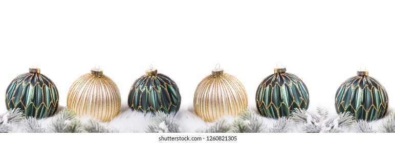 Border from green and golden balls and fir tree branches  isolated on white background. Decorative christmas composition. Selective focus.  Place for text.