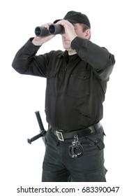 Border guard wearing black uniform looking through binocular, shot on white