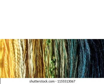 Border image of balls of yarns in varying textures, forming color sequence from left to right; this blends into close-up of yarn strands in same color sequence at bottom. White background at top.