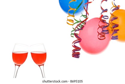 Border made from colorful balloons  confetti  and a drink isolated on white background