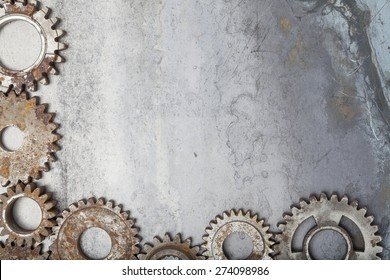 A border made up of interlocking rusty gears over a grungy steel background.