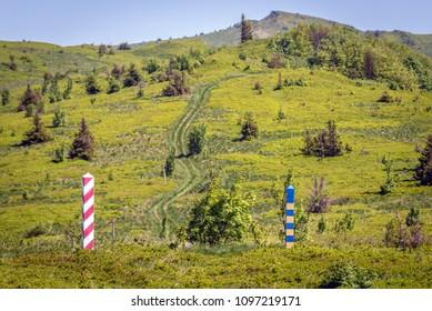Border markes on a Polish-Ukraine boundary, seen from a trail in Bieszczady Mountains National Park, Poland