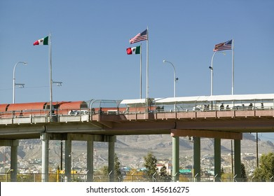 Border of Mexico and the United States, with flags and walking bridge connecting El Paso Texas to Juarez, Mexico