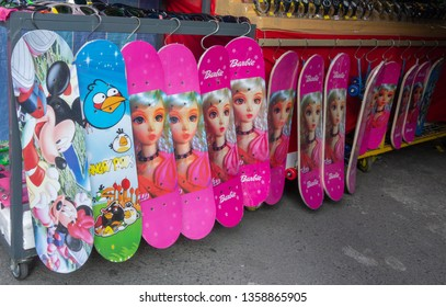 BORDER of PADANG BESAR, PERLIS, MALAYSIA and THAILAND - CIRCA 2015 : Various fake barbie and disney merchandise being sold openly at a market in the border of Perlis/Malaysia and Thailand.