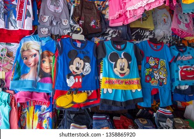 BORDER of PADANG BESAR, PERLIS, MALAYSIA and THAILAND - CIRCA 2015 : Various fake disney merchandise being sold openly at a market in the border of Perlis/Malaysia and Thailand.