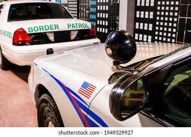 Border patrol car with open back door for arrested immigrants concept