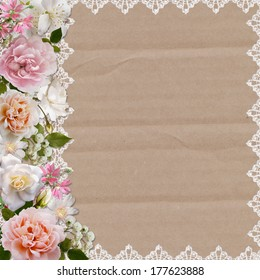 Border of roses and lace on a cardboard background
