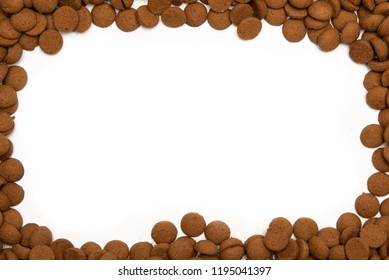 Border with traditional dutch candy, pepernoten on white background