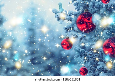 Border winter nature christmas background with frozen spruce, glitter lights, bokeh, snow. View through white frost pine branch. Happy new year. Text space. Elements of this Image Furnished by NASA
