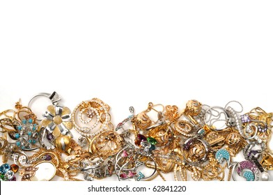 Border of yellow and white gold jewelry, on the white