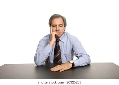 bored business man on a desk, isolated on white
