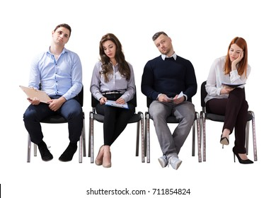 Bored Business People Sitting In Row Waiting For Job Interview Against White Background
