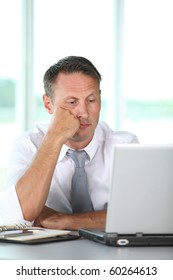 Bored businessman in front of computer