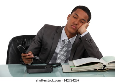 Bored businessman making phone calls