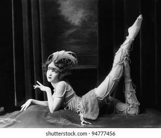Bored dancer posing in beaded costume