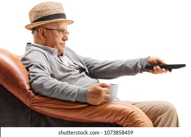 Bored elderly man sitting in an armchair and watching television isolated on white background