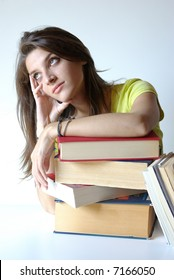 Bored Girl student and pile of books