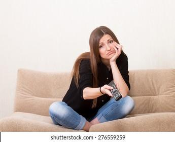 Bored girl watching TV