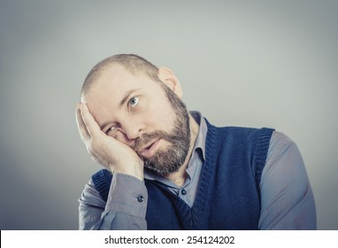 bored man over grey background