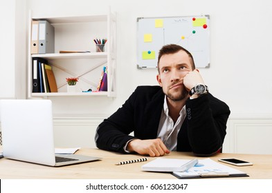 Bored office worker, annoyed businessman at workplace