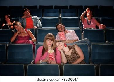 Bored people fall asleep in a theater