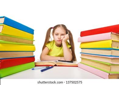 Bored schoolgirl with pile of books. homework. Isolated.