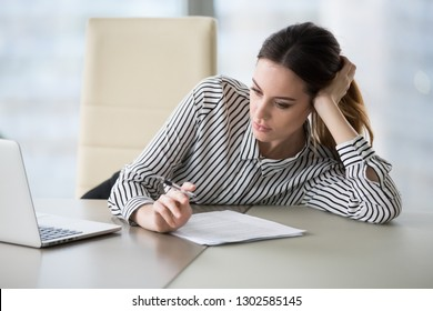 Bored secretary feeling lack of motivation or ideas tired of boring job and dull paperwork, absent-minded lazy female office worker wasting time at workplace unmotivated about monotonous work routine