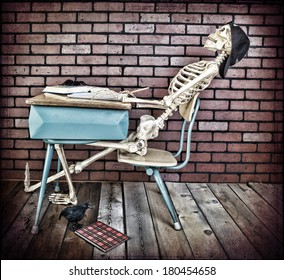 A bored skeleton student sleeping in class.