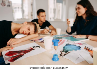 Bored sleepy designer sitting asleep at workplace, lazy man disinterested in boring routine, tired employee falling asleep at desk, lack of sleep