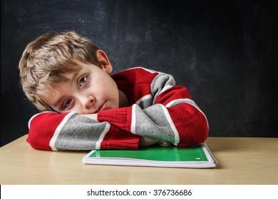 Bored student laying his head on his desk