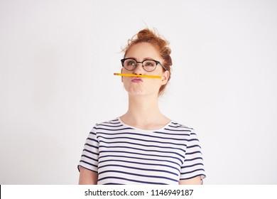 Bored woman having fun with pencil