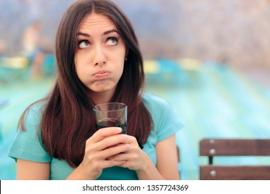 Bored Woman with Soda Glass in a Restaurant. Bad mood girlfriend felling bored at her date