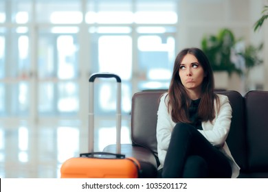 Bored Woman with Suitcase in Airport Waiting Room Upset girl traveling along waiting for the next flight