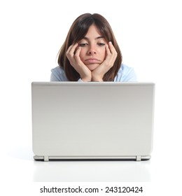 Bored woman watching a laptop isolated on a white background