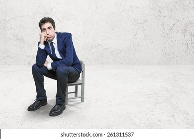 bored worker on little chair