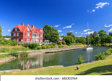 BORENSBERG, SWEDEN - JULY 13, 2015: Sailboat on the Götakanal in Borensberg with the Göta Hotell