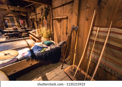 Borg - June 15, 2018: Viking weapons and artifacts Inside the Longhouse in the Lofotr Viking Museum at the town of Borg in the Lofoten Islands, Norway