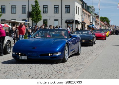 BORGHOLM, SWEDEN - JUNE 13, 2015: Chevrolet Corvette parade in Sweden at a car meet 2015. In front of the parade is a blue 2002 Corvette Cabriolet.  Photo taken on June 13, 2015 at Borgholm in Sweden.