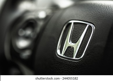 BORGUND, NORWAY - AUGUST 1, 2014: Honda Black Steering Wheel And Silver Star Logo