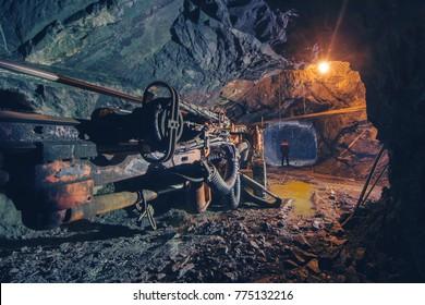 Boring machine make a passage in the rock.