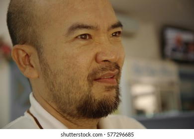 boring or unhappy face of Asia bald beard man